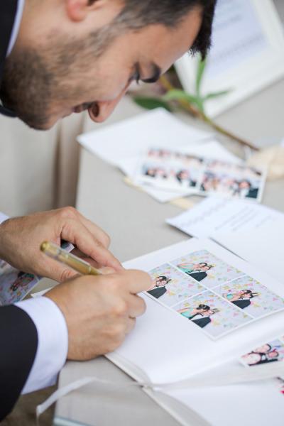 Libro de firmas hecho con fotos de la cabina - Ideas para entretener a los invitados de la Boda